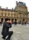 My friend Efren took a photo of me while I'm trying to get the best angle of the Pyramid at the Louvre in France.