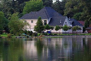 This house  reflects its beauty in the lake.  I took this photo from across the Botanical Garden in Norfolk Virginia.